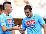 Napoli's midfielder Marek Hamsik of Slovakia congratulates his teammate Argentinian forward Gonzalo Gerardo Higuain during the Italian Serie A football match Chievo vs Napoli on August 31, 2013