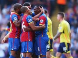 Kagisho Dikgacoi of Crystal Palace celebrates the opening goal with team mates, scored by Danny Gabbidon during the Barclays Premier League match between Crystal Palace and Sunderland at Selhurst Park on August 31, 2013