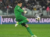 Fraser Forster of Celtic kicks the ball during the UEFA Champions League round of 16 second leg match between Juventus and Celtic at Juventus Arena on March 6, 2013
