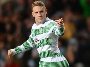 Celtic midfielder Kris Commons celebrates after a goal against Shakhtar Karagandy on August 28, 2013