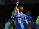 The Referee Steve Bratt shows a red card to David Connolly of Portsmouth during the Sky Bet League Two match between Portsmouth and Chesterfield at Fratton Park on August 31, 2013