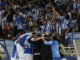 Real Sociedad players celebrate after Carlos Vela gives them the lead against Lyon on August 28, 2013