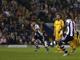 West Brom's Saido Berahino scores a penalty to seal his hat-trick against Newport during their League Cup match on August 27, 2013