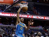 Anthony Davis #23 of the New Orleans Hornets dunks the ball in front of Nenê #42 of the Washington Wizards during the first half at Verizon Center on March 15, 2013