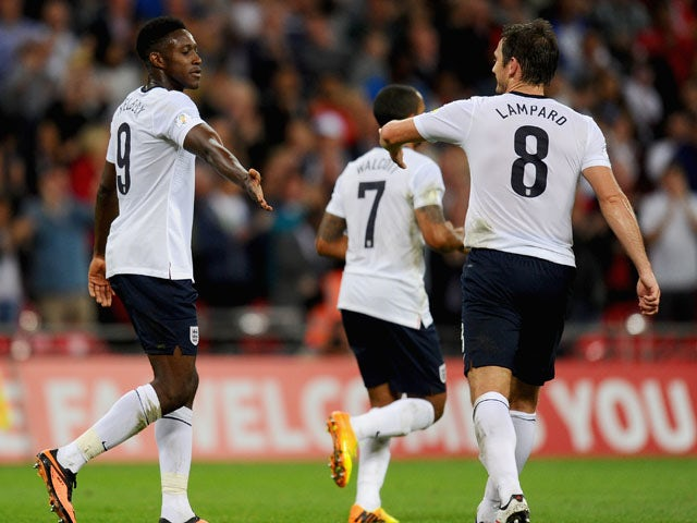 Danny Welbeck of England is congratulated by Frank Lampard of England on acroing their third goal during the FIFA 2014 World Cup Qualifying Group H match between England and Moldova at Wembley Stadium on September 6, 2013