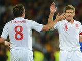 Frank Lampard and Steven Gerrard celebrate an England goal against Moldova.