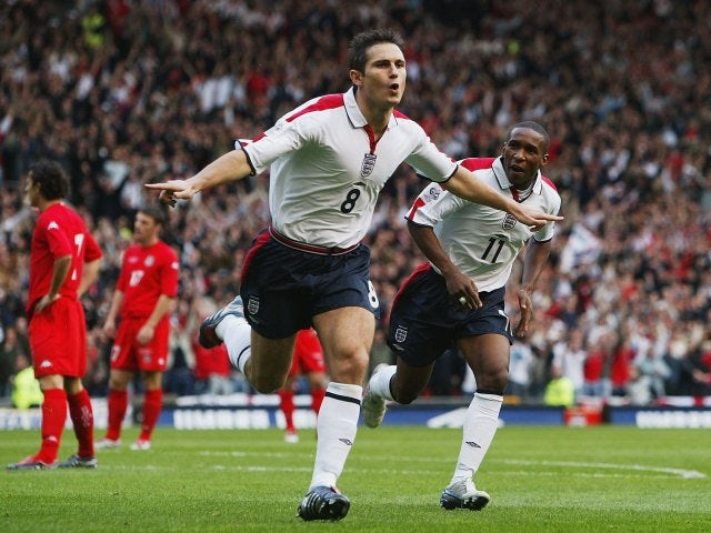 Frank Lampard celebrates scoring for England against Wales in a World Cup qualifier at Old Trafford.