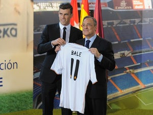 Gareth Bale is presented as a Real Madrid player by president Florentino Perez at the Bernabeu on September 2, 2013
