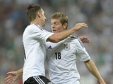 Germany's striker Miroslav Klose and midfielder Toni Kroos celebrate after the second goal for Germany during the FIFA World Cup 2014 group C qualifying football match of Germany vs Austria on September 6, 2013