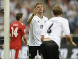 Germany's striker Thomas Mueller and Germany's defender Benedikt Hoewedes celebrate after the third goal for Germany during the FIFA World Cup 2014 group C qualifying football match of Germany vs Austria on September 6, 2013
