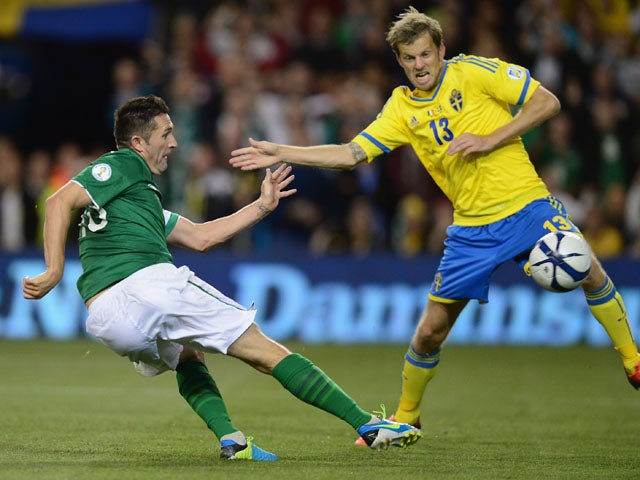 Robbie Keane of Republic of Ireland scores his goal during the FIFA 2014 World Cup Qualifying Group C match between Republic of Ireland and Sweden at Aviva Stadium on September 6, 2013