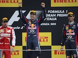 Red Bull Racing's German driver Sebastian Vettel and Red Bull Racing's Australian driver celebrates on the podium at the Autodromo Nazionale circuit in Monza on September 8, 2013