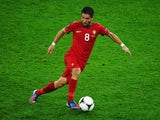 Portugal midfielder Joao Moutinho with the ball against Germany in their Euro 2012 match on June 9, 2012