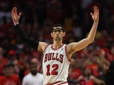 Kirk Hinrich #12 of the Chicago Bulls celebrates during the final minute of triple overtime against the Brooklyn Nets in Game Five of the Eastern Conference Quarterfinals in the 2013 NBA Playoffs at the United Center on April 27, 2013