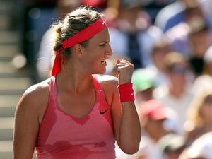 Victoria Azarenka of Belarus reacts during her women's singles semifinal match against Flavia Pennetta of Italy on Day Twelve of the 2013 US Open at USTA Billie Jean King National Tennis Center on September 6, 2013