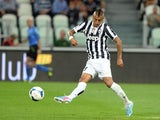Arturo Vidal of FC Juventus scores the first goal during the Serie A match between Juventus and SS Lazio at Juventus Arena on August 31, 2013