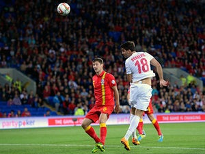 Half-Time Report: Serbia cruising in Cardiff