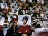 Manchester United fans pay tribute to the late George Best before a match with West Bromwich Albion in 2005.