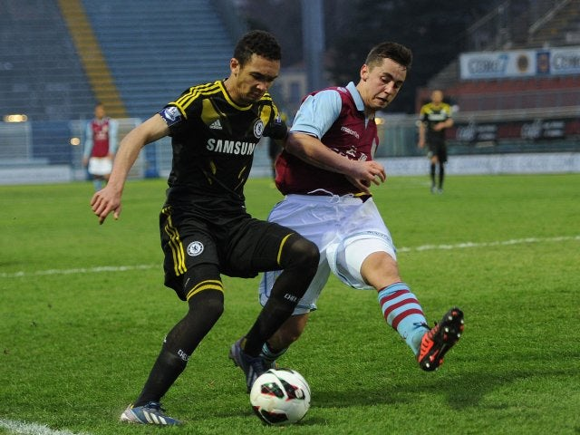 Aston Villa defender Lewis Kinsella attempts to block a cross during the 2013 NextGen Series final.