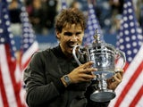 Rafael Nadal poses with the US Open trophy after defeating Novak Djokovic in four sets in New York on September 9, 2013
