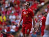 Robbie Fowler of Liverpool in good spirits after a near miss provided by Steven Gerrard during the Steven Gerrard Testimonial Match between Liverpool and Olympiacos at Anfield on August 03, 2013