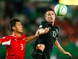 Ireland's Robbie Keane and Austria's Aleksandar Dragovic battle for the ball during their World Cup qualifier on September 10, 2013