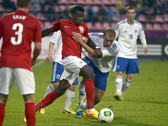 Finland's Tim Vayrynen and England's Wilfried Zaha battle for the ball during their U21 European Championships qualifying match on September 9, 2013