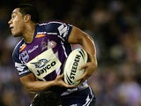Willie Isa of the Storm is tackled by Bill Tupou of the Warriors during the round seven NRL match between the Melbourne Storm and the Warriors at Etihad Stadium on April 25, 2010