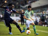 Lyon's Bakary Kone and Betis' Chuli battle for the ball during their Europa League group match on September 19, 2013