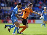 Shrewsbury Town's Connor Goldson and Wolves' Bjorn Sigurdarson battle for the ball during their League One match on September 21, 2013