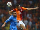 Galatasaray's Burak Yilmaz jumps for a header over Real defender Daniel Carvajal on September 17, 2013