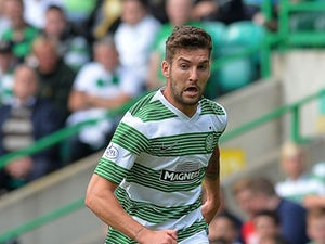 Charlie Mulgrew of Celtic in action during the Scottish Premier League game between Celtic and Ross County at Celtic Park Stadium on August 03, 2013