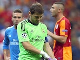Real Madrid 'keeper Iker Casillas leaves the field injured against Galatasaray on September 17, 2013