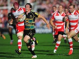 Northampton Saints' James Wilson races ahead to score a try against Gloucester during their Aviva Premiership match on September 21, 2013