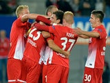 Freiburg's Julian Schuster is congratulated by team mates after scoring the opening goal against Slovan Liberec during their Europa League group match on September 19, 2013