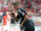 Leverkusen's Lars Bender celebrates after scoring his team's second goal against Mainz during their Bundesliga match on September 21, 2013