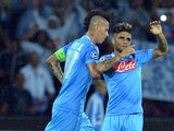 Napoli's Lorenzo Insigne is congratulated by team mate Marek Hamsik after scoring his team's second goal against Dortmund during their Champions League group match on September 18, 2013