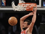 Bulls player Marco Belinelli scores a slam dunk against the Nets on May 5, 2013