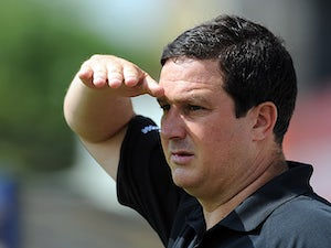 Mansfield Town manager Paul Cox watches his team play Nottingham Forest during a friendly match on July 13, 2013