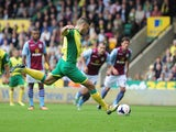 Norwich's Robert Snodgrass takes a penalty against Aston Villa during their Premier League match on September 21, 2013