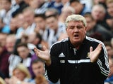 Hull boss Steve Bruce encourages his players during the game with Newcastle on September 21, 2013