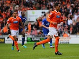 Blackpool's Tom Ince celebrates after scoring the equaliser from the penalty spot against Leicester during their Championship match on September 21, 2013