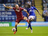 Derby's Conor Sammon and Leicester's Zoumana Bakayogo battle for the ball during their League Cup match on September 24, 2013