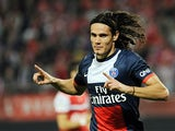 Paris Saint-Germain's Edinson Cavani celebrates after scoring the opening goal against Valenciennes during their Ligue 1 match on September 25, 2013