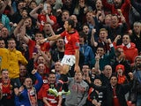 Man United's Javier Hernandez celebrates in front of fans after scoring the opening goal against Liverpool during their League Cup match on September 25, 2013