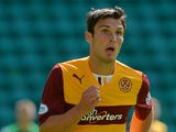 John Sutton of Motherwell in action during the Scottish Premiership League match between Hibernian and Motherwell at Easter Road on August 04, 2013