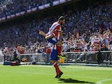 Atletico Madrid's Brazilian forward Diego da Silva Costa celebrates with Atletico Madrid's Turkish midfielder Arda Turan after scoring during the Spanish league football match Club Atletico de Madrid vs RC Celta de Vigo at the Vicente Calderon stadium in