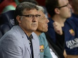 Barcelona's Argentinian coach Gerardo Martino looks on during the Spanish league football match FC Barcelona vs Real Valladolid CF at the Camp Nou stadium in Barcelona on October 5, 2013