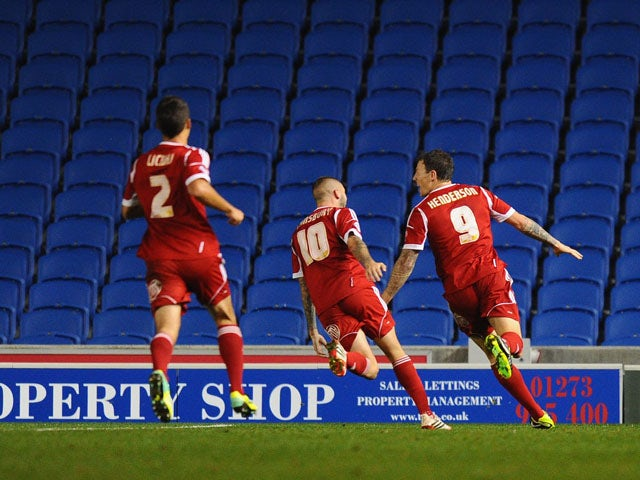 Darius Henderson of Nottingham Forest celebrates after scoring during the Sky Bet Championship match between Brighton & Hove Albion and Nottingham Forest at Amex Stadium on October 5, 2013