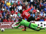 Newcastle United's Dutch goalkeeper Tim Krul vies for the ball against Cardiff City's English striker Fraizer Campbell during the English Premier League football match between Cardiff City and Newcastle United at The Cardiff City Stadium in Cardiff, south
